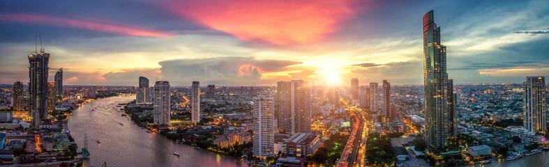 Aerial view of Bangkok buildings, Bangkok city downtown with sunset sky, Transaction beautiful road top view at night traffic Fotomurales