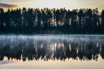 Reflections on the foggy lake