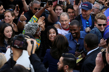 An attendee reacts while meeting U.S. Senator Harris following a rally to launch her campaign for U.S. president at a rally in Oakland
