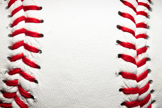 Vertical red stitches on a baseball