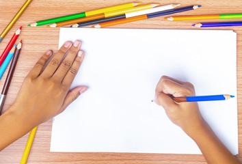 Child draws a pencil drawing