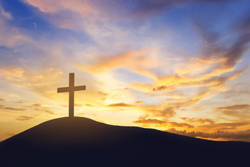 sunrise and cross on mountain
