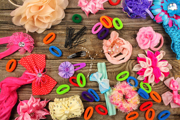 Different hair clips on wooden background. Top view.