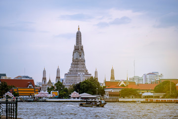 Wat Arun is a landmark and a tourist attraction of Thailand. And the Chao Phraya River