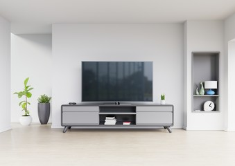 Tv design on cabinet interior modern room with plants,shelf,lamp on white wall,3D rendering