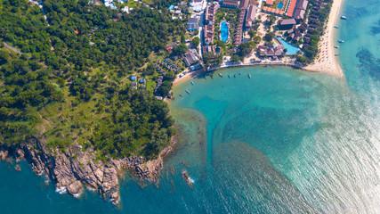 AERIAL : Beachfront resort with sea view on beautiful tropical island of koh Phangan, sandy coastline and palm trees