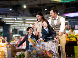 asian family shopping in supermarket