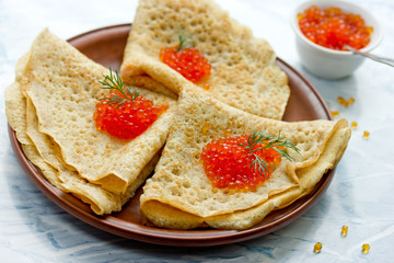 Delicious pancakes with red caviar