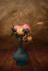 vase with flowers on vintage background