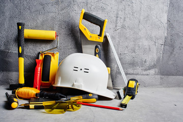 set of construction tools on a black wall background Fototapete