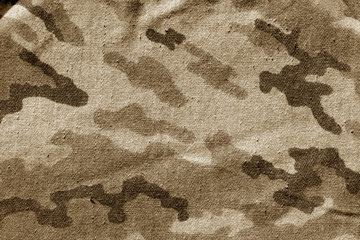 Dirty camouflage cloth in brown tone.