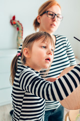 Little Girl Painting With Her Mother