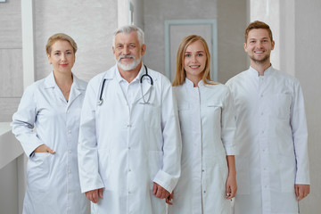Four professionals during their shift in hospital.