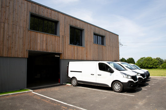 Modern wood new company warehouse building outdoors entrance with truck delivery van