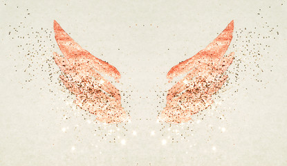 Golden glitter on abstract pink watercolor wings in vintage nostalgic colors.