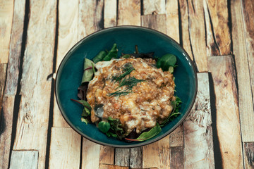 Moussaka, Oriental dish common to Turkey, Greece and the Balkans, consisting of aubergines baked.