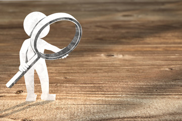3D Illustration weißes Männchen aus Papier mit Lupe