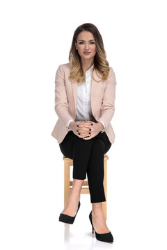 young businesswoman sitting and waiting for interview
