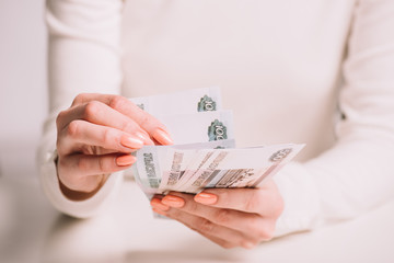 cropped shot of woman counting russian rubles banknotes, selective focus
