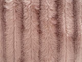 Fake, faux fur fluffy background, beige stripes.