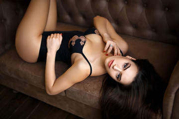 Sensual woman in a sexy black lingerie