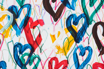 background of abstract colorful painted hearts on white background