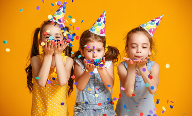 Foto op Canvas Carnaval happy birthday children girls with confetti on yellow background