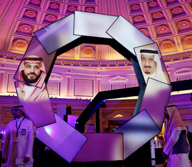 Pictures of Saudi Arabia's Crown Prince Mohammed bin Salman and Saudi Arabia's King Salman bin Abdulaziz are seen during the launching of National Industrial Development and Logistics Program (NIDLP) in Ritz-Carlton hotel in Riyadh