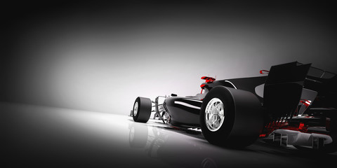 Back of F1 car on light background.