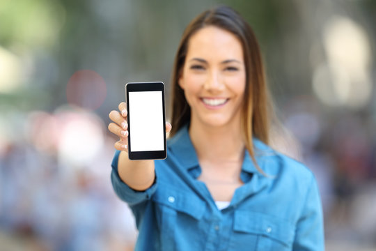 Happy woman showing smart phone mock up