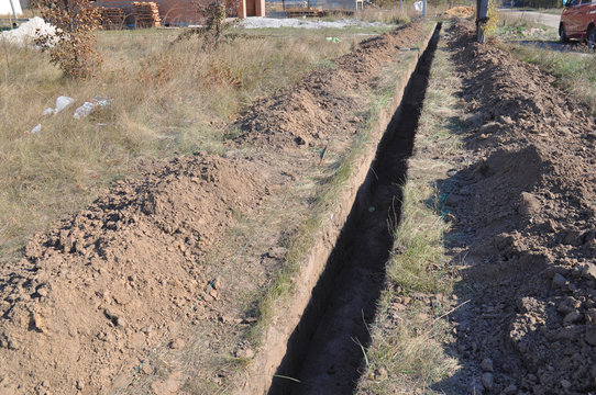 Pipe Excavation, Bedding and Backfill. Pipe trench and bedding. Trench for pipes.