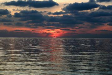 stunning fiery sunset over the calm sea
