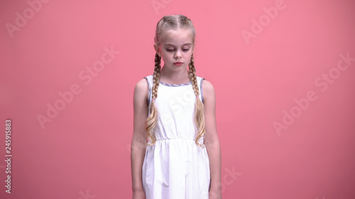 d2a6a0cd3463 Sad little girl standing alone, suffering from parents divorce, bullying  concept