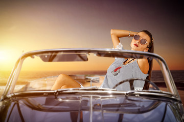 Summer car and slim young woman