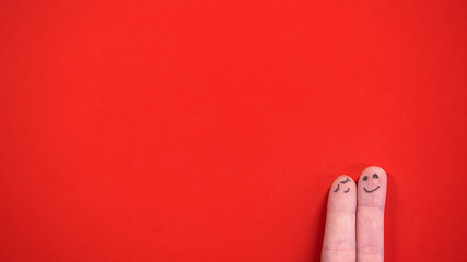 Cuddling finger face couple isolated on red background, happy Valentines Day