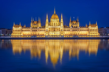 Budapest parliament illuminated at night and Danube river, Hungary