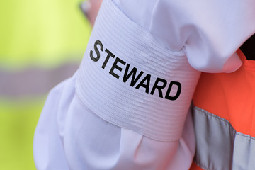 """Detail of an armband with text """"STEWARD"""""""