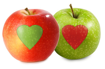 Fototapete - isolated image of two apples with cut out heart closeup