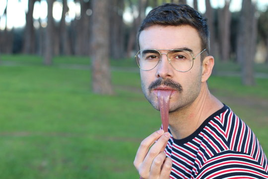 Weird image of man stretching his tongue out