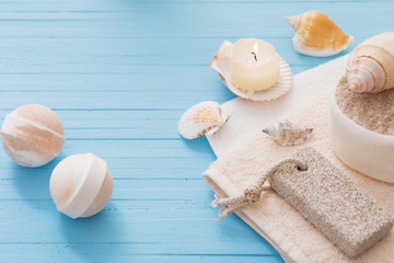 Spa concept with candles on blue wooden background