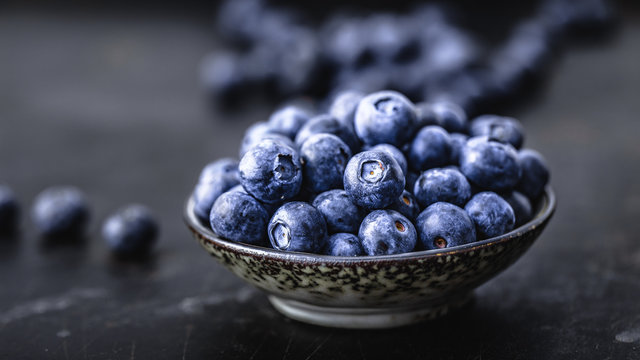 Juicy and fresh blueberries on a beautiful background