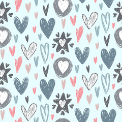 Vector seamless pattern with hand drawn hearts in sketch style.
