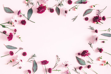 Flowers composition. Eucalyptus leaves and pink flowers on pastel pink background. Flat lay, top view, copy space