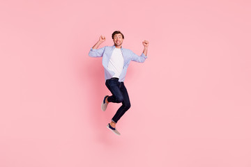 Deurstickers Hoogte schaal Full length body size photo of jumping high crazy cheer he his him handsome glad yelling loudly arms raised teeth revealed wearing casual jeans checkered plaid shirt isolated on rose background