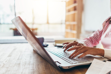 Woman working from home using notebook computer