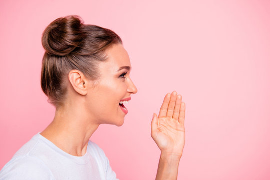 Profile side view portrait of her she nice winsome attractive lovely sweet cheerful cheery girl lady saying speech story teller isolated over pastel pink background