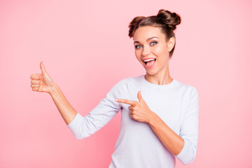 Portrait of nice-looking cute adorable attractive lovely cheerful cheery positive funny girl showing thumbup isolated over pink pastel background