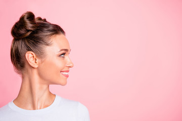 Close-up profile side view of nice lovely cute fascinating attractive groomed cheerful cheery girl looking aside copy empty blank space place isolated over pink pastel background