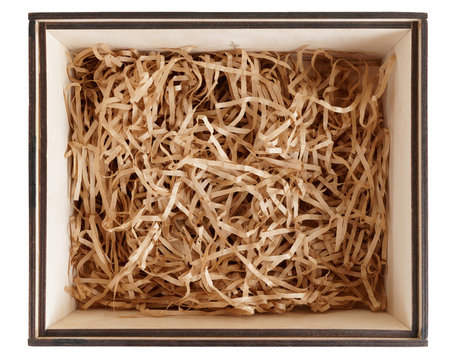 Wooden box with shredded paper, shot from above