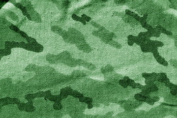 Dirty camouflage cloth in green tone.